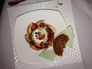 Almond Tofu with nectarine and red berries macerated in peach schapps basil honeycombe and praline